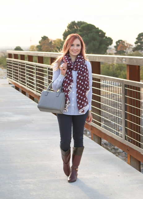With striped shirt, pants, high boots and gray bag