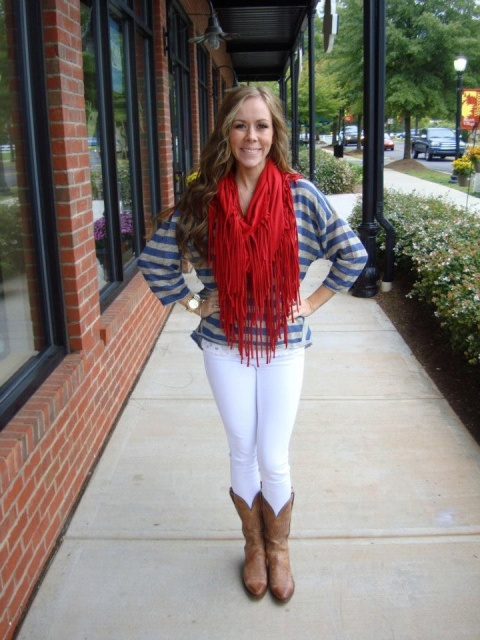 With striped shirt, white pants and brown high boots