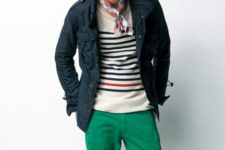 With striped sweater, navy blue jacket and green pants