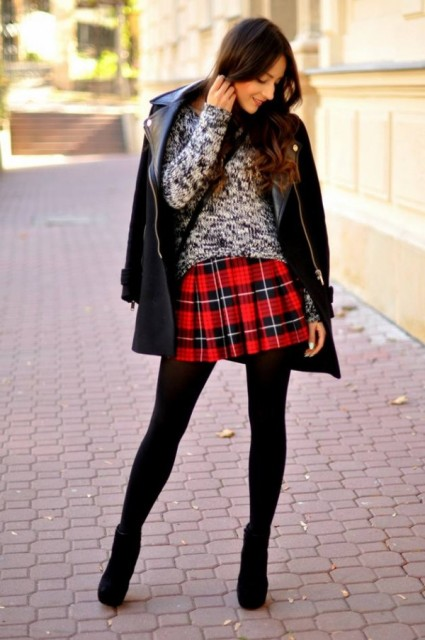 With sweater, leather jacket, black tights and ankle boots