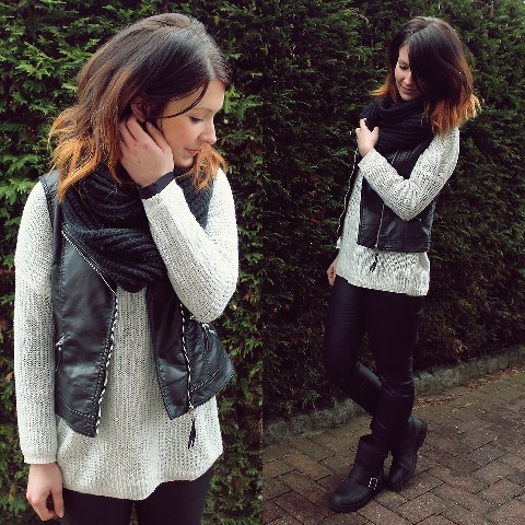 With sweater, leather pants and ankle boots