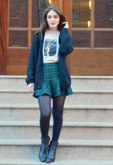 With t-shirt, cardigan and ankle boots