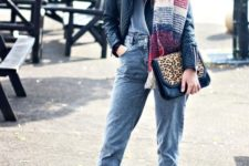 With t-shirt, leather jacket, leopard clutch, cuffed pants and black ankle boots