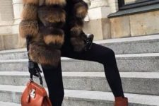 With turtleneck, black leggings, brown ankle boots and brown small bag