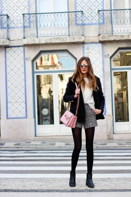 With white blouse, black jacket, light pink bag and ankle boots