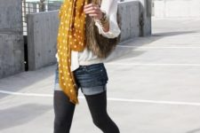 With white blouse, denim shorts, black tights, black boots and fur vest