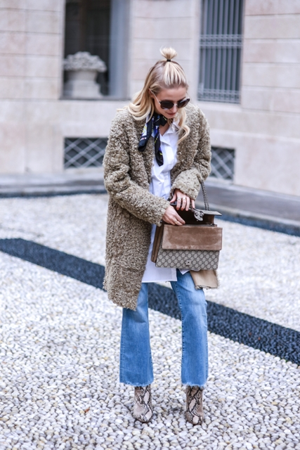 With white long shirt, coat, crop jeans, snake print boots and bag