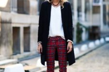 With white loose shirt, long blazer and brown leather boots