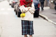 With white oversized sweater, oversized scarf, yellow bag and mid calf boots