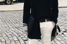 With white pants, mid calf boots, shirt, coat and bag