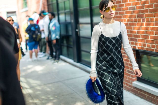 With white shirt and checked slip dress