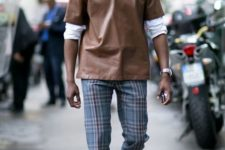 With white shirt, brown leather shirt and black shoes