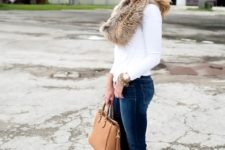 With white shirt, cuffed jeans, ankle boots and camel bag