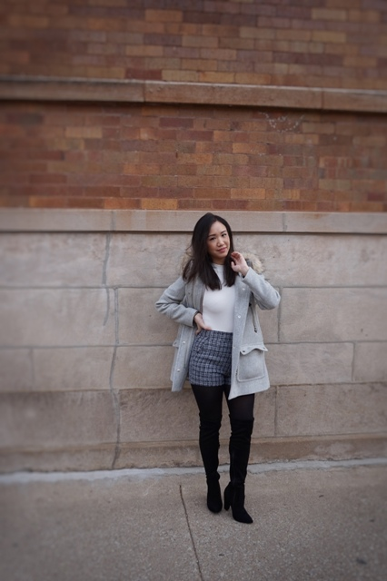 With white shirt, gray cardigan and over the knee boots