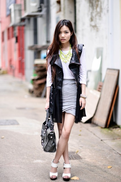 With white shirt, gray wrap skirt, white shoes and black bag