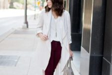 With white shirt, marsala trousers, velvet boots and gray bag