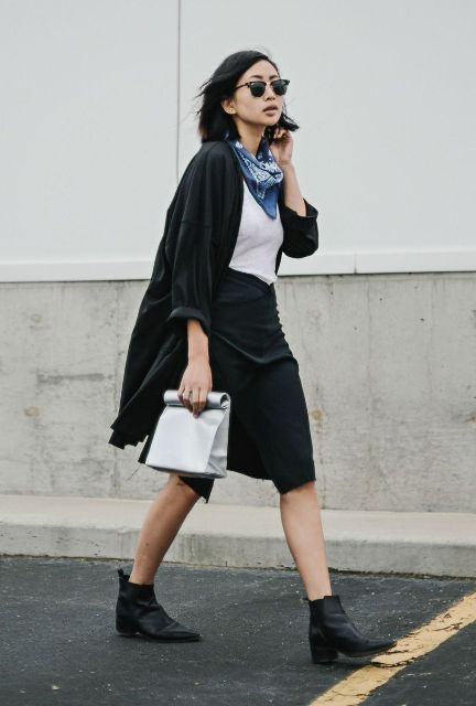 With white shirt, midi skirt, ankle boots and black cardigan