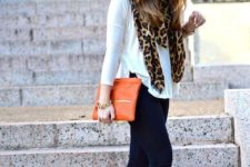 With white shirt, navy blue pants, orange clutch and boots