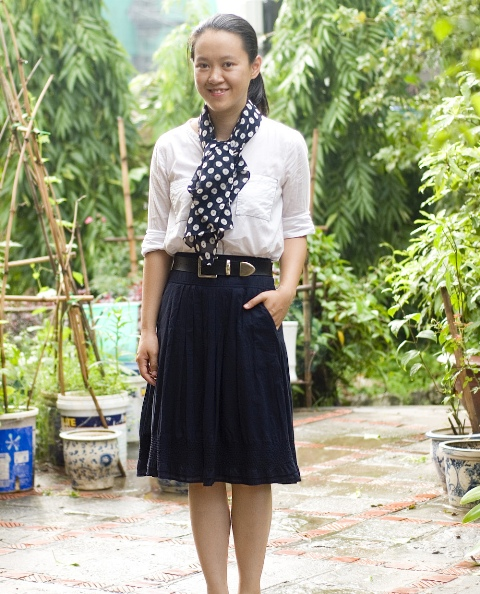 With white shirt, navy blue skirt and black leather belt
