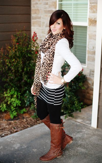 With white shirt, striped skirt and brown boots