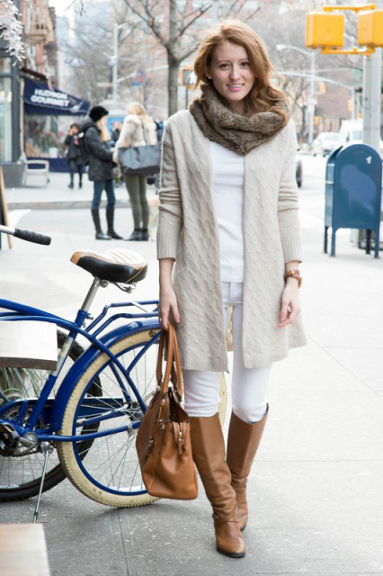 With white shirt, white pants, beige long cardigan, brown high boots and brown bag