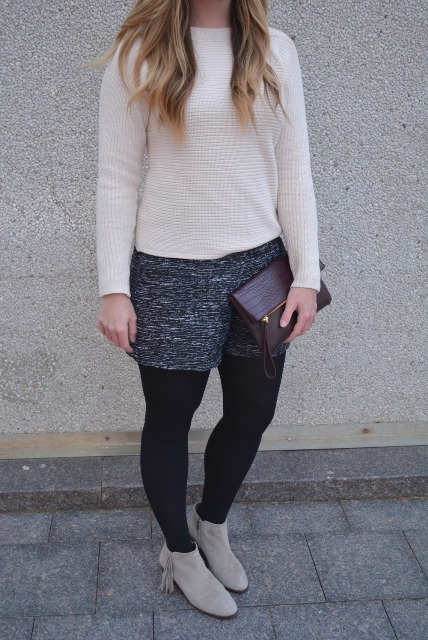 With white sweater, gray suede boots and clutch