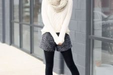 With white sweater, knitted scarf, sunglasses, black tights and ankle boots