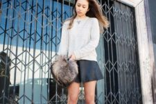 With white sweatshirt, leather mini skirt and lace up shoes