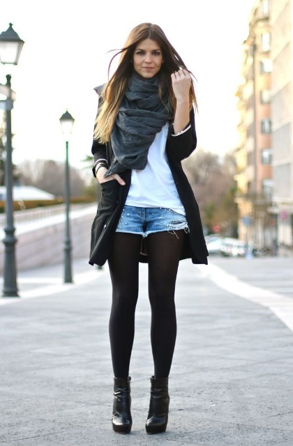 With white t shirt, black coat, gray scarf and ankle boots