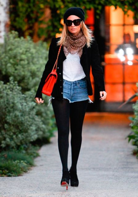 With white t shirt, black tights, black beanie, heels, printed scarf, red bag and black jacket