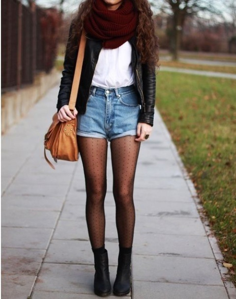 With white t-shirt, leather jacket, polka dot tights, ankle boots and brown bag