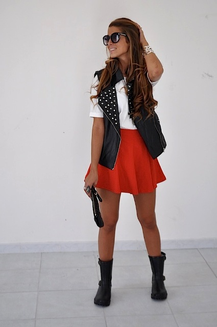 With white t-shirt, red mini skirt, mid calf boots and clutch