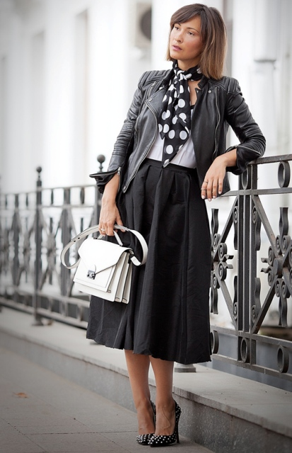 With white top, midi skirt, embellished shoes, black leather jacket and white bag