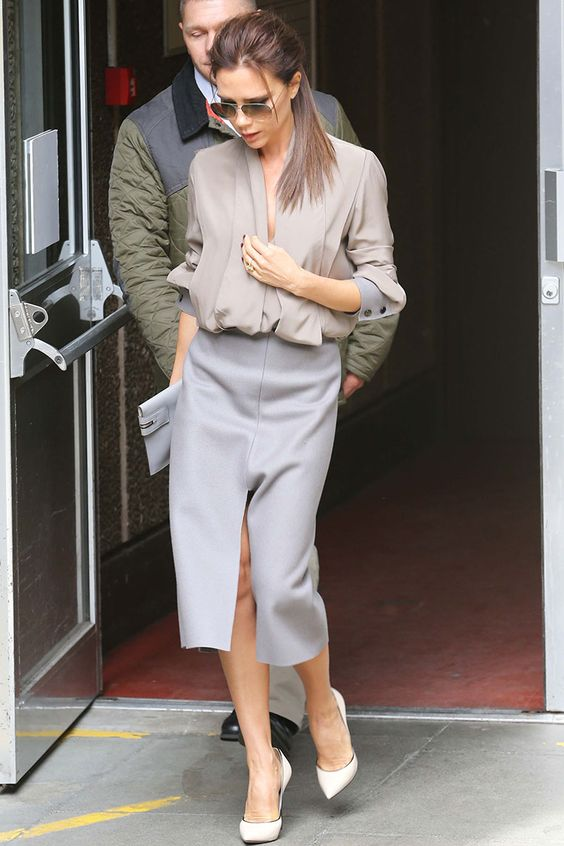 a taupe blouse, a grey pencil skirt with a front slit, creamy shoes and a grey clutch