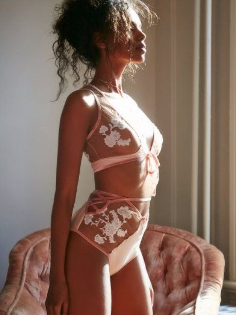 pink and white lace lingerie set with bows and sheer detailing and lacing