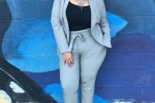 03 a chic light grey suit with a black top, a statement necklace and hot pink heels for a bold look