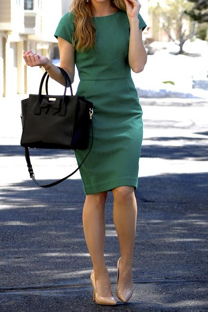 an emerald knee dress, a black bag and nude shoes