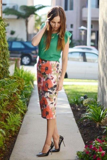 an emerald sleeveless top, a midi floral pencil skirt, black heels for a bold summer look