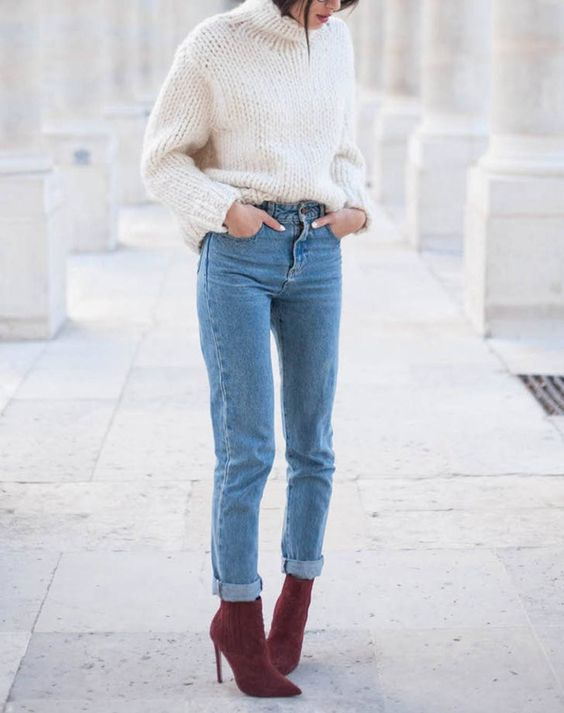 blue denim, a white chunky knit sweater and plum-colored sock boots