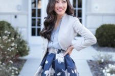 04 a full navy floral print skirt, a grey v-neck shirt, a cropped creamy jacket and a brown bag