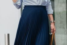 04 a navy pleated midi skirt, a striped blue shirt, a statement necklace and nude heels