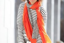 04 a striped black and white top, checked pants, an orange and printed scarf as an accent