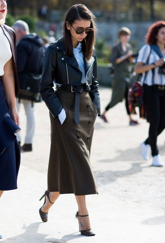 black ankle strap shoes, a brown midi skirt with buttons, a blue shirt and a cropped blakc leather jacket