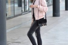 04 black cropped jeans, a black top, a light pink bomber jacket, white sneakers and a black bag