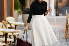 05 a black long sleeve top, a white textural A-line midi, dove grey heels and a burgundy tote