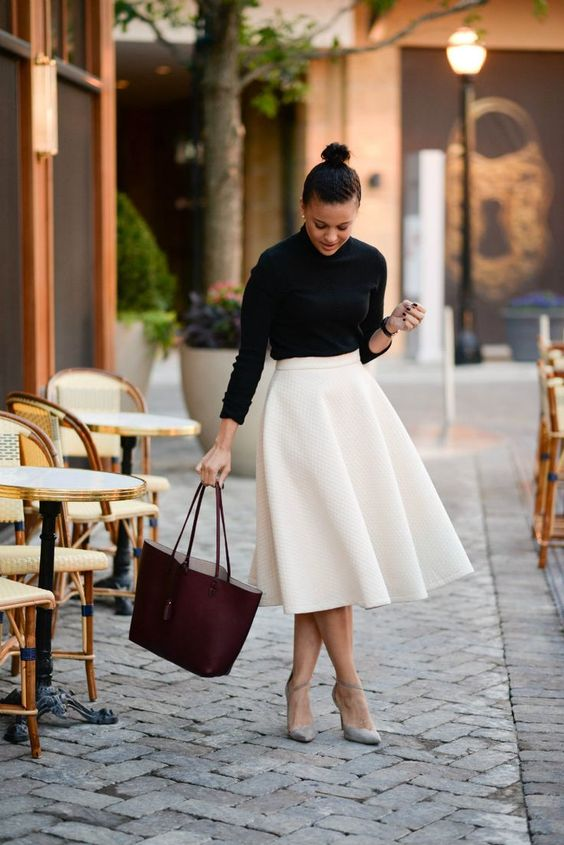 a black long sleeve top, a white textural A line midi, dove grey heels and a burgundy tote