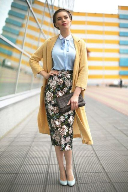 a blue shirt, a floral pencil midi skirt, a yellow coat and powder blue heels