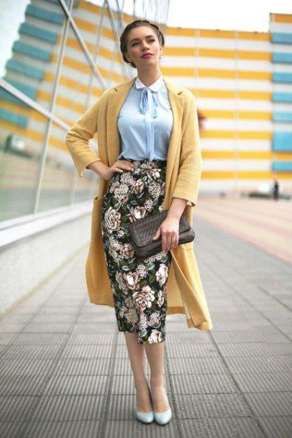 a blue shirt, a floral pencil midi skirt, a yellow coat and powder blue heels