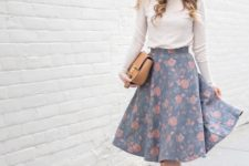 05 a floral muted-color A-line midi skirt, strappy heels, a neutral turtleneck and a tan bag