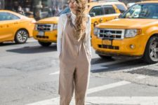 05 a white turtleneck, a tan loose jumpsuit, grey grunge boots for a super stylish transitional look